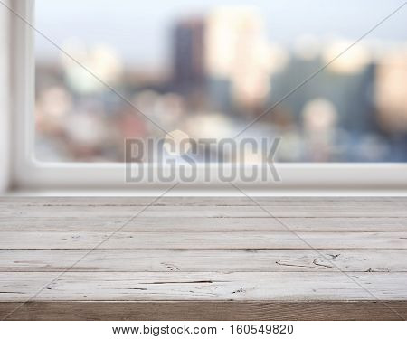 Wooden texture planks on abstract city lights background
