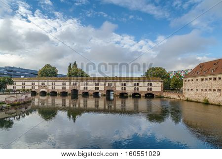 The Barrage Vauban or Vauban Dam is a bridge weir and defensive work erected in the 17th century on the River Ill in the city of Strasbourg in France