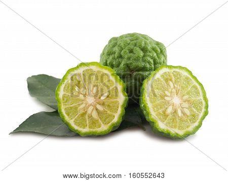 Fresh bergamot (kaffir lime) vegetable slice with leaf isolated on white background