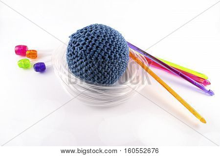Tunisian crochet hook and juggling ball isolated on white background