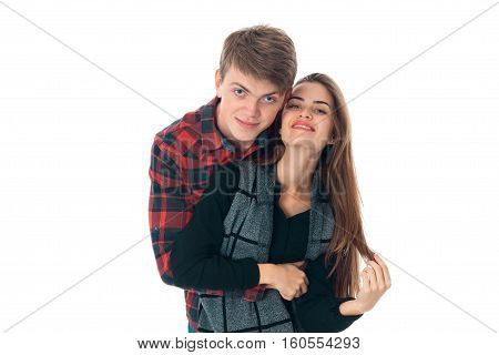 portrait of young fun stylish couple in love having fun in studio isolated on white background
