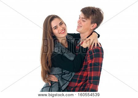 portrait of funny young stylish couple in love having fun in studio isolated on white background