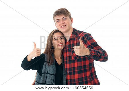 portrait of fun stylish couple in love having fun in studio isolated on white background