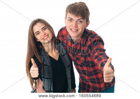 close up of young adorable stylish couple in love having fun in studio isolated on white background