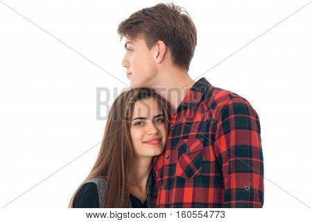 close up of young fun stylish couple in love having fun in studio isolated on white background