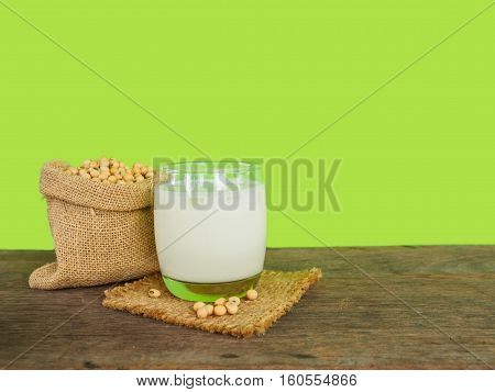 Soy beans and soy milk on wooden tabel for drinking everyday has health benefits green color background