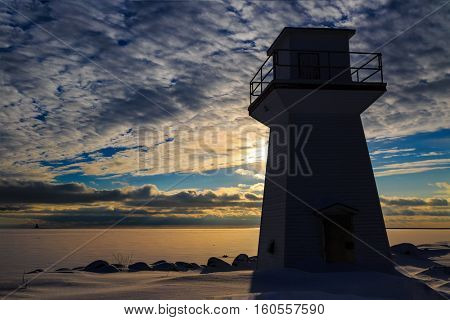 Lighthouse or range light along the waterfront of Summerside, Prince Edward Island at sunset.