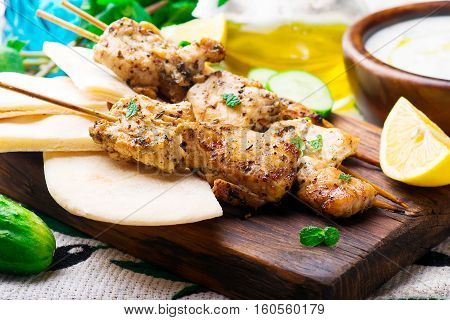 Chicken Souvlaki with pita and tzatziki.selective focus