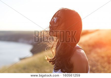 Gorgeous Romantic Girl Outdoors. Beautiful Long Hair Model in Field. Backlit, Warm Color Tones