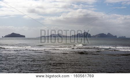 Large enormous mountains standing in the sea