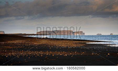 Coastline with black sand near the city Vik