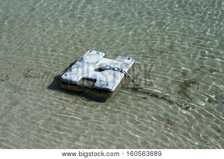 a boat chain anchor on the sea