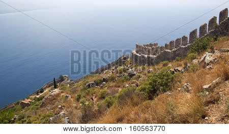 Alanya Castle / Walls fortress of Alanya Kale. Alanya Castle (Alanya Kalesi) is a medieval castle in the southern Turkish city of Alanya.