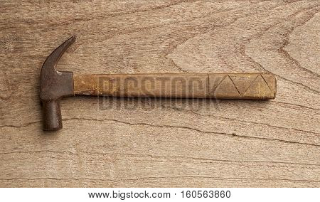 Hammer on wood background  ndoors, construction, woodwork,