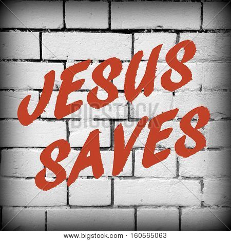 The words Jesus Saves in red text on a black and white brick wall background. A vignette has been added for effect
