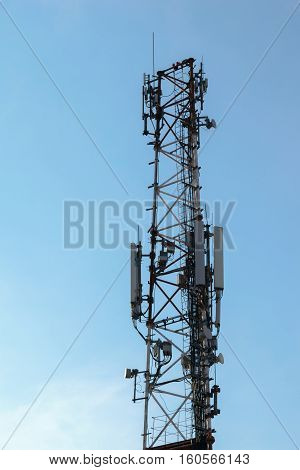 wireless comunication tower with antenna on clear sky