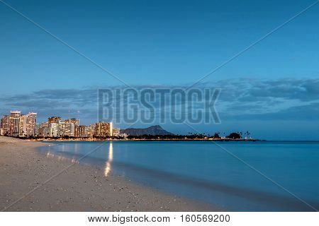 Long exposure of Diamond Head and Waikiki skyline as seen from Ala Moana Beach Park in Honolulu Hawaii