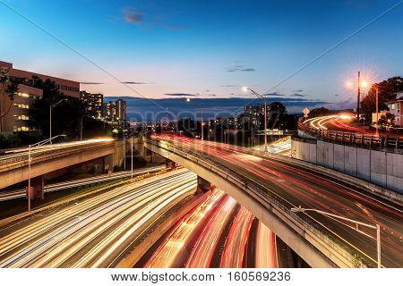 Light streaks over highway, exits and on ramps in downtown, Honolulu
