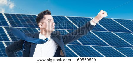 Successful Businessman Flying Over Photovoltaic Installation