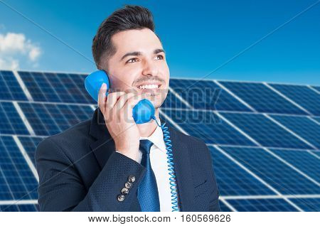 Portrait Of Joyful Business Man Talking On Telephone