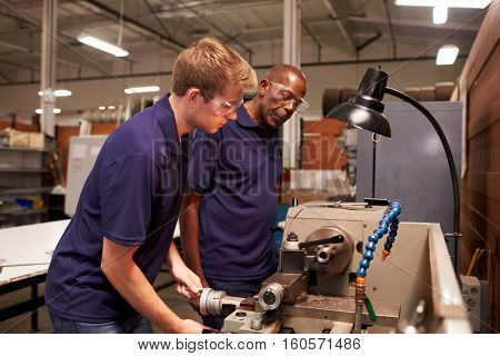 Engineer Training Male Apprentice On Milling Machine