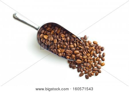 Coffee beans in metal scoop isolated on white background. Top view.