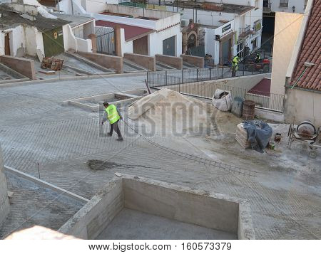 Alora Spain - November 11 2016: Workers being busy restructuring steep village street