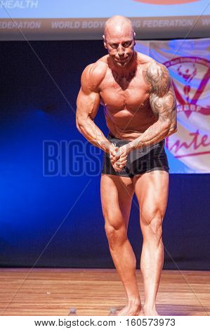 MAASTRICHT THE NETHERLANDS - OCTOBER 25 2015: Male bodybuilder Erik Stobbe shows his best most muscular pose at the World Grandprix Bodybuilding and Fitness of the WBBF-WFF