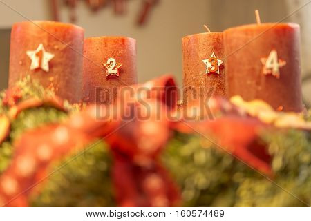 Advent wreath with red candles and fir - third advent