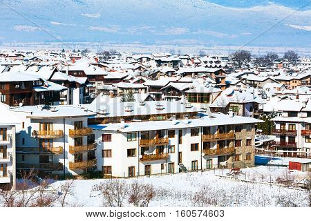Houses with snow roofs panorama of bulgarian ski resort Bansko, Bulgaria
