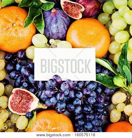 Fruit Background with Blank Business Card Grape Figs Plum and Tangerines Fruits. Diet and Healthy Eating Concept