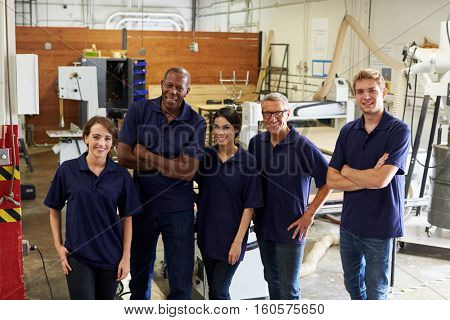 Portrait Of Carpenters In Busy Woodworking Factory