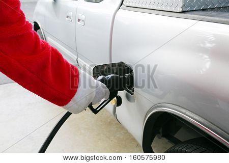 Santa Claus Gas Station Fill up. Santa refuels his truck before Christmas eve.