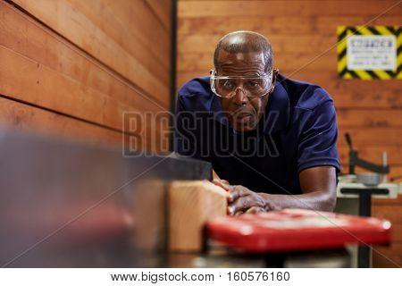 Carpenter Using Plane In Woodworking Woodshop