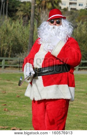 Christmas Santa Claus plays golf. Santa Golf. Hipster Santa wears his Golf Hat