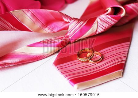 Two wedding rings on the tie, happy