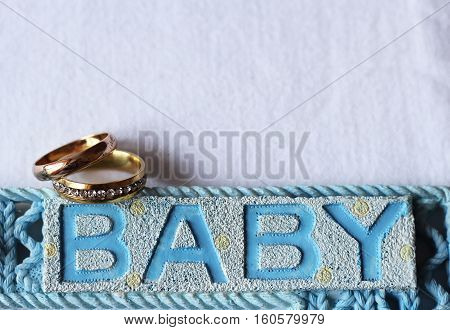Wedding rings and text BABY, blue color