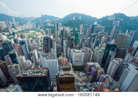 Skyscrapers and buildings in Hong Kong city, China at summer, top view from China Resources Building