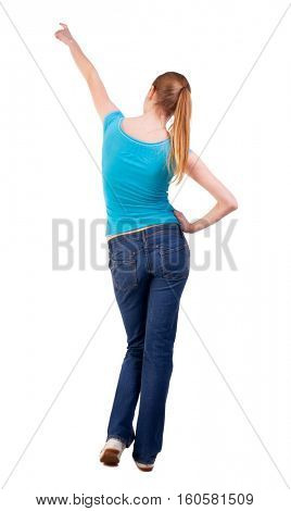 Back view of  pointing woman. beautiful blonde  girl in jeans.  Rear view people collection.  backside view person.  Isolated over white background. long-haired blonde hair tied in a bun shows what is