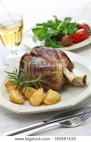 pork shank with roasted potatoes, italian cuisine, stinco di maiale con patate arrosto