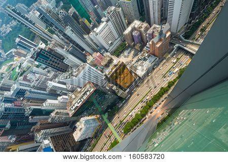Skyscrapers, buildings, highway in Hong Kong city, China at summer, top view from China Resources Building