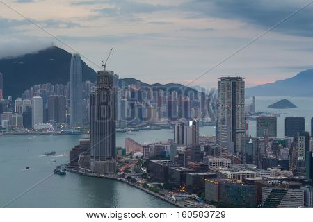 International Commerce Centre skyscraper on sea shore in business area, ships at evening in Hong Kong, China, view from Harbourfront center
