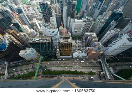 Skyscrapers and buildings in Hong Kong city, China at summer, aerial view from China Resources Building