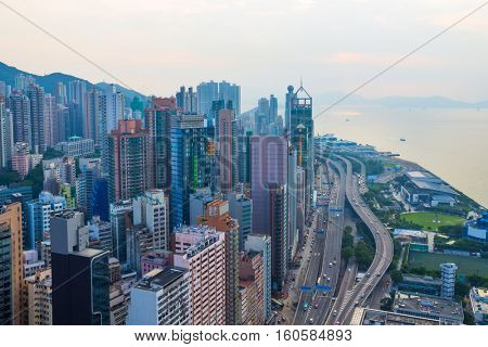 Skyscrapers, highway on coast in business area at morning in Hong Kong, China, view from China Merchants Tower