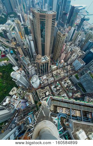 High skyscrapers, many office buildings in Hong Kong city, China, top view from Manulife Plaza