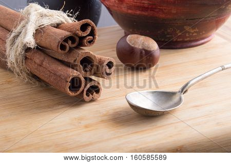 Bunch Of Cinnamon Sticks And Vintage Silver Spoon