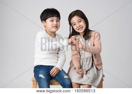 Young Asian brother and sister studio shot
