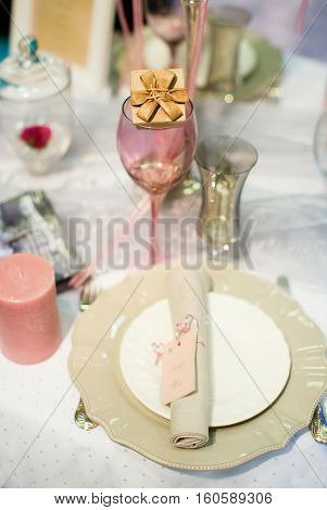 Table Set With A Small Compliment For Guests
