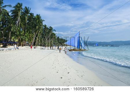 parawa outrigger sailbotas on boracay white beach popular tourist destination in the philippines