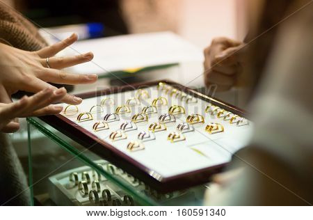 Woman Trying Wedding Rings At A Jeweller